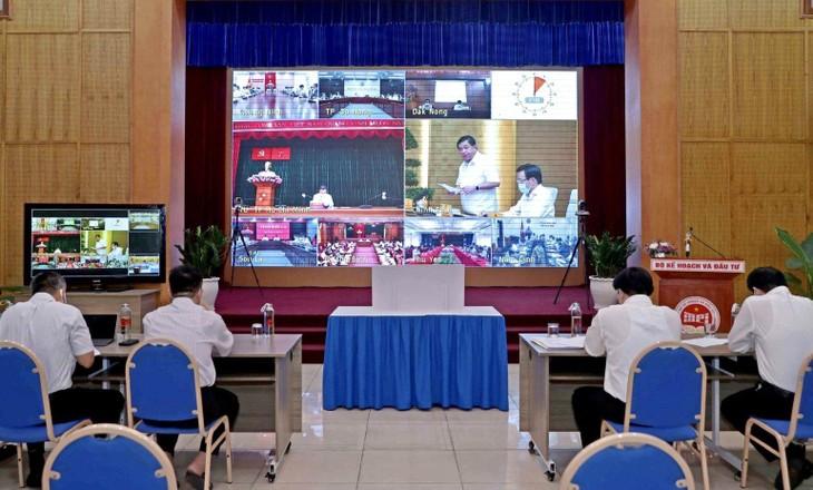 Bộ trưởng Nguyễn Chí Dũng phát biểu tại Hội nghị (ảnh chụp từ điểm cầu Bộ Kế hoạch và Đầu tư). Ảnh: Đức Trung