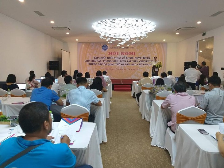 """Quang cảnh Hội nghị """"Tập huấn kiến thức về BHXH, bảo hiểm y tế. Ảnh Trần Nam"""
