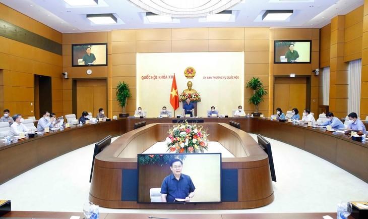 4 quy định khác Luật sẽ được áp dụng để phòng, chống Covid-19 đã được Uỷ ban Thường vụ Quốc hội biểu quyết thông qua chiều ngày 6/8/2021 tại Hà Nội - ảnh Thành Chung