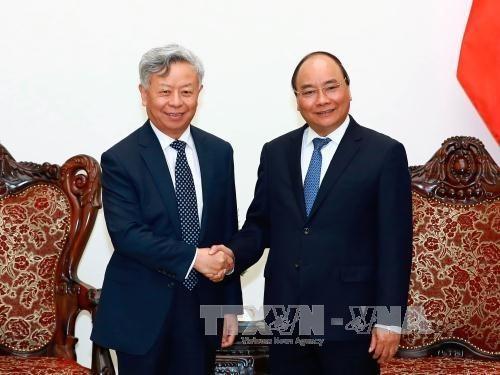 Thủ tướng Nguyễn Xuân Phúc tiếp ông Kim Lập Quần, Chủ tịch Ngân hàng Đầu tư Cơ sở hạ tầng châu Á (AIIB). Ảnh: Thống Nhất/TTXVN