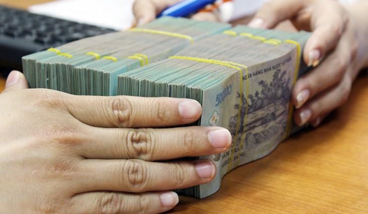 Bộ trưởng Bộ Tài chính Đinh Tiến Dũng cho rằng, đối với vay nợ của DNNN theo cơ chế tự vay tự trả, doanh nghiệp là bên vay có trách nhiệm thực hiện nghĩa vụ trả nợ theo quy định của pháp luật. Ảnh: Tường Lâm