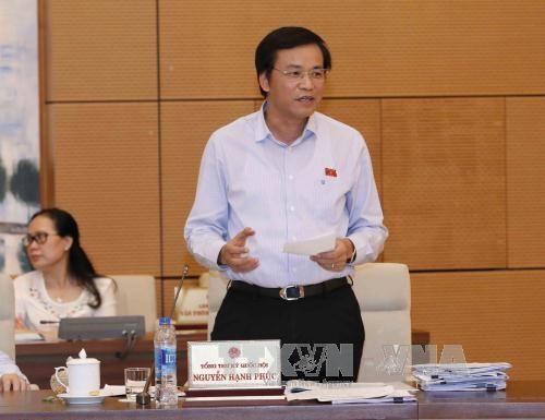 Tổng Thư ký Quốc hội Nguyễn Hạnh Phúc phát biểu ý kiến. Ảnh: TTXVN