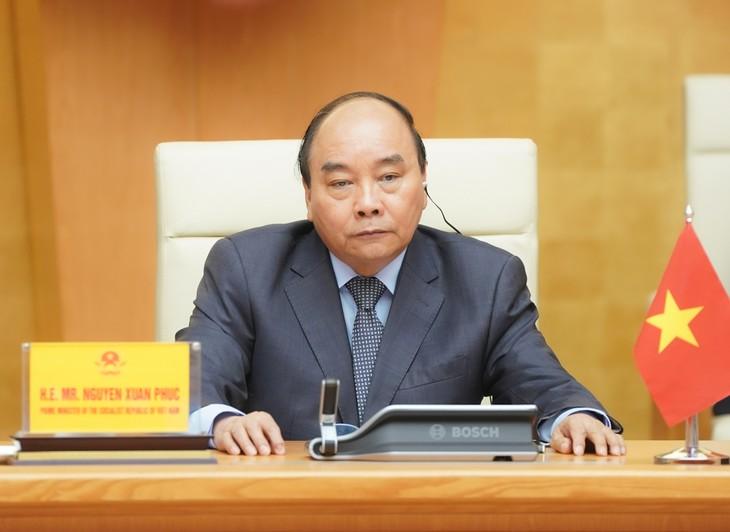 Thủ tướng Nguyễn Xuân Phúc dự Hội nghị Thượng đỉnh trực tuyến G20 ứng phó COVID-19. Ảnh: VGP
