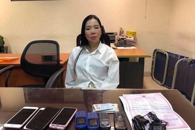 Bị can lừa đảo, làm giả bệnh án tâm thần Nguyễn Thị Mai Anh khi bị bắt giữ. Ảnh cơ quan công an.