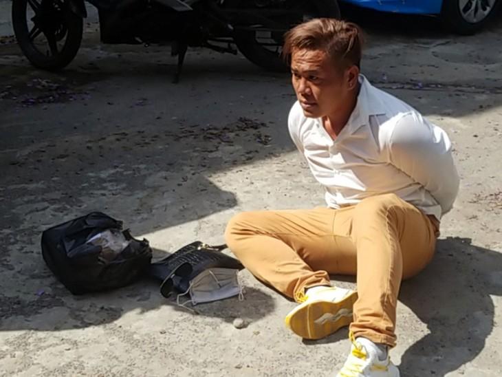 Trương Thái Hậu bị cảnh sát khống chế hôm 27/4. Ảnh: Công an cung cấp.