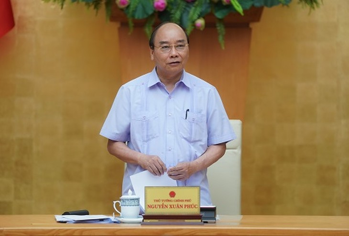 Thủ tướng Nguyễn Xuân Phúc chủ trì cuộc họp - Ảnh: VGP