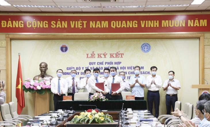 Quyền Bộ trưởng Bộ Y tế Nguyễn Thành Long và Tổng Giám đốc BHXH Việt Nam Nguyễn Thế Mạnh ký Quy chế phối hợp giữa hai cơ quan