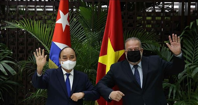 Chủ tịch nước Nguyễn Xuân Phúc và Thủ tướng Cuba Manuel Marrero Cruz.