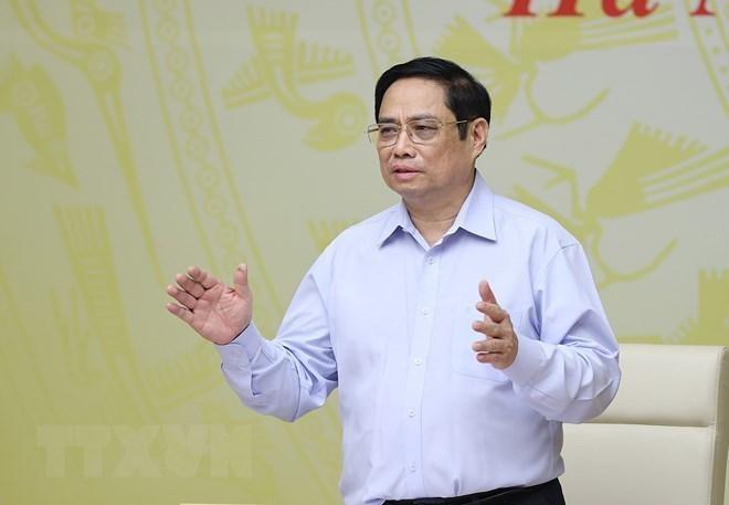 Thủ tướng Phạm Minh Chính chủ trì hội nghị. Ảnh: TTXVN