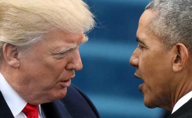 Tổng thống Mỹ Donald Trump (trái) và người tiền nhiệm Barack Obama. (Ảnh: Getty)