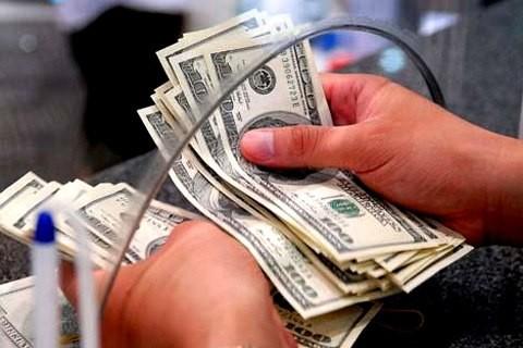 Giá USD ngân hàng bật tăng vài chục đồng. Ảnh:PV.