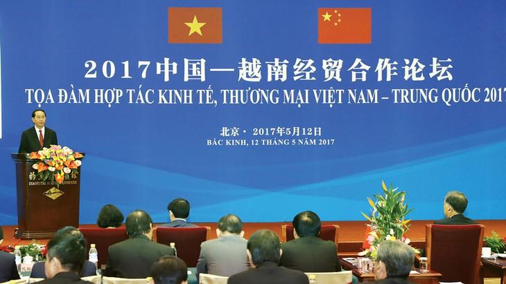 Chủ tịch nước Trần Đại Quang phát biểu tại Tọa đàm Hợp tác kinh tế, thương mại Việt Nam - Trung Quốc vừa diễn ra ở Bắc Kinh. Ảnh: TTXVN