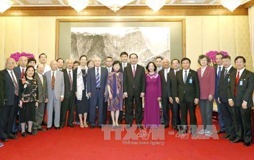 Chủ tịch nước Trần Đại Quang và Đoàn Đại biểu Hội Hữu nghị đối ngoại nhân dân Trung Quốc, Hội Hữu nghị Trung-Việt và thân nhân các nhân sĩ, cán bộ, chuyên gia Trung Quốc có quan hệ hữu nghị với Việt Nam. Ảnh: TTXVN