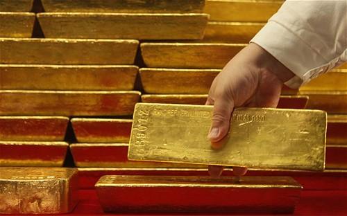 Đôla tăng giá khiến giá vàng đi xuống. Ảnh:Telegraph.