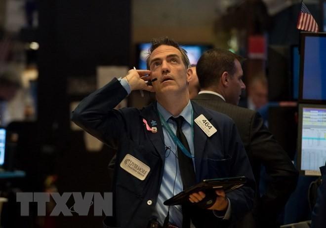 Giao dịch viên tại Sàn giao dịch chứng khoán New York, Mỹ. (Nguồn: AFP/TTXVN)