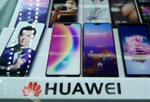 Biểu tượng của khổng lồ viễn thông Huawei, Trung Quốc. Ảnh: AFP/TTXVN