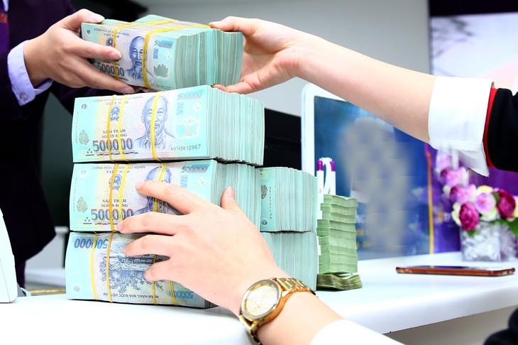 Tình trạng thanh toán bằng tiền mặt và không xuất hóa đơn là một trong những trở ngại với việc quản lý và thu thuế hoạt động thương mại điện tử. Ảnh: Nhã Chi