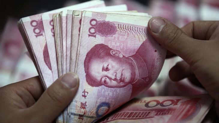 Diễn biến lắt léo của đồng Nhân dân tệ khiến nhiều đồng tiền giảm giá khá mạnh so với USD. Ảnh: Reuters
