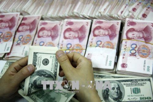 Giá đồng Nhân dân tệ biến động trái chiều. Ảnh: Reuters/ TTXVN