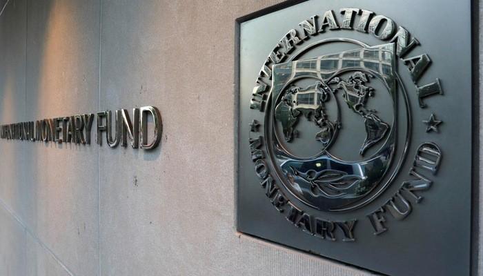 Logo IMF tại trụ sở định chế này ở Washington - Ảnh: Reuters.