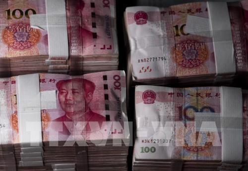 Giá đồng Nhân dân tệ tăng mạnh. Ảnh: AFP/TTXVN