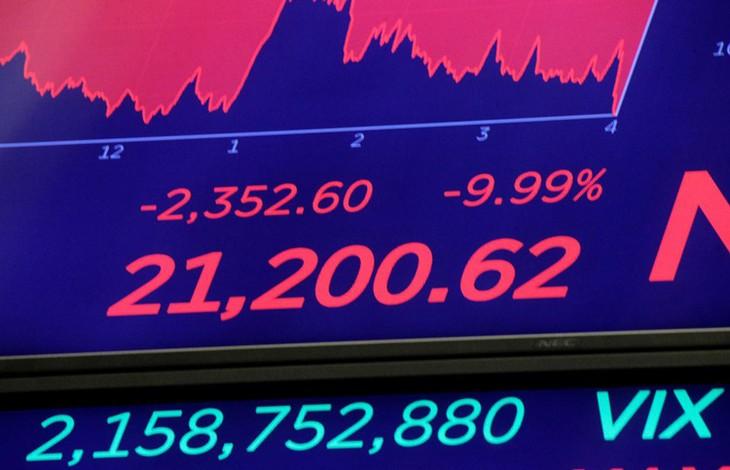 Màn hìnhtrênSàn giao dịch chứng khoán New York (NYSE) sau khi kết thúc phiên giao dịch 12/3 tại New York, Mỹ.Ảnh: Reuters.