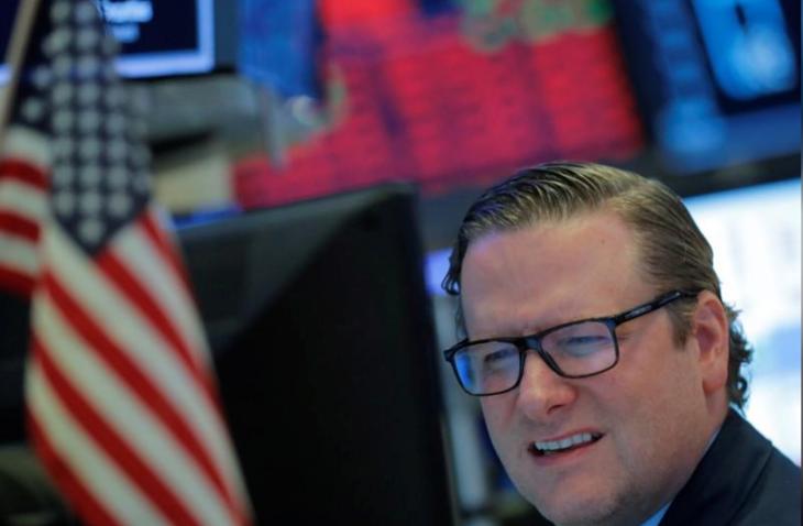 Nhân viên giao dịch trên sàn chứng khoán New York trong phiên ngày 18/3. Ảnh:Reuters