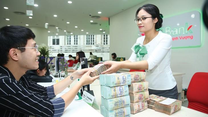 Chính sách của Ngân hàng Nhà nước nhận được sự hưởng ứng của các ngân hàng, mang lại hiệu ứng tích cực cho nền kinh tế. Ảnh: Lê Tiên