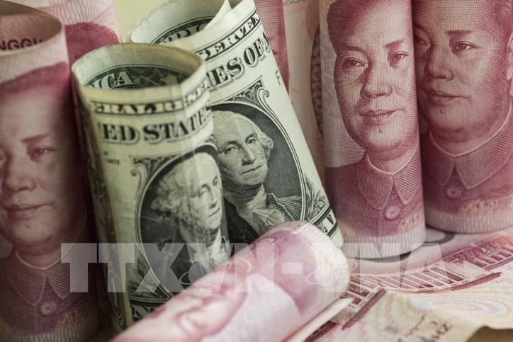 Sáng nay giá USD và đồng Nhân dân tệ (NDT) cùng giảm. Ảnh: TTXVN phát