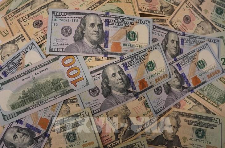Đồng USD tại một ngân hàng ở Washington, DC. Ảnh: THX/TTXVN