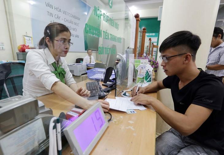 Nợ xấu ngân hàng sẽ tăng đáng kể vào cuối năm 2020 hoặc đầu năm 2021, khi chính sách hỗ trợ khách hàng bị ảnh hưởng do dịch Covid-19 hết hiệu lực. Ảnh: Trần Việt