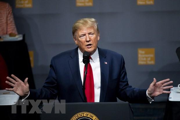 Tổng thống Trump khẳng định ông đã trả hàng triệu USD tiền thuế. (Ảnh: AFP/TTXVN)