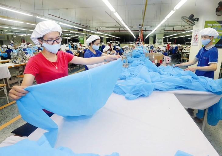 Hỗ trợ doanh nghiệp nhằm tháo gỡ khó khăn, vượt qua Covid-19 được coi là giải pháp quan trọng, động lực cho nền kinh tế trong giai đoạn tới. Ảnh: Việt Trần