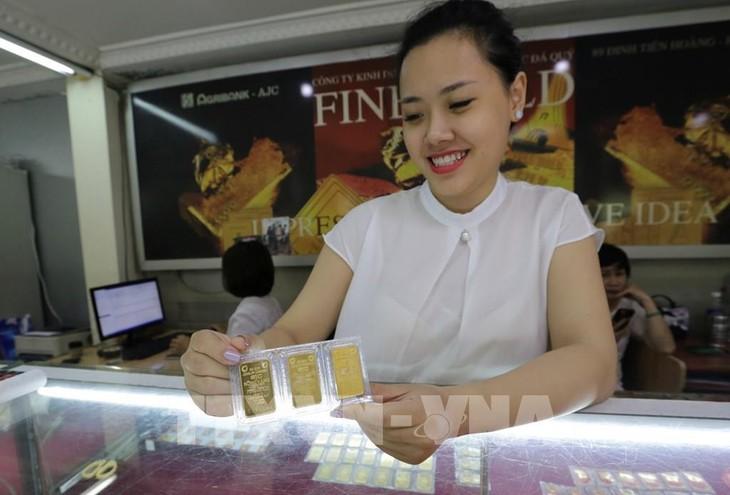 Giá vàng giảm 150 nghìn đồng/lượng. Ảnh: Trần Việt - TTXVN