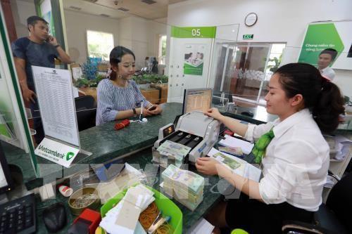 Tại các ngân hàng thương mại, sáng nay, giá đồng Nhân dân tệ (NDT) tiếp tục tăng, trong khi giá đồng USD duy trì ổn định. Ảnh minh họa: Trần Việt - TTXVN