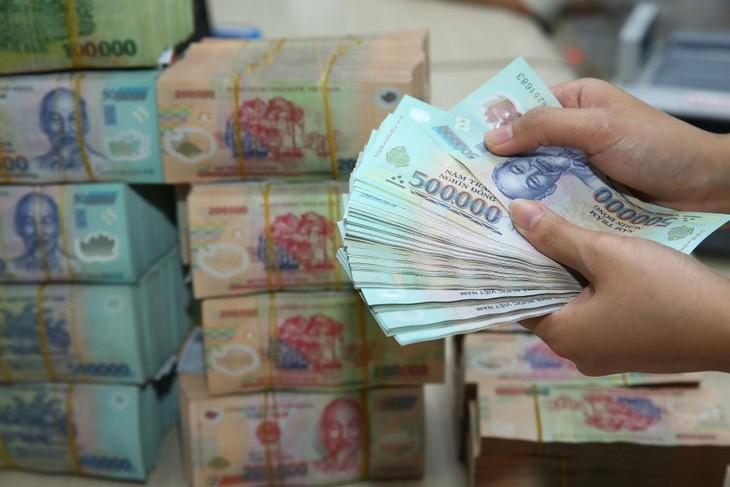 Trong tháng 5, số tiền trả nợ của Chính phủ là khoảng 30.516 tỷ đồng, trong đó trả nợ trong nước khoảng 26.967 tỷ đồng, trả nợ nước ngoài khoảng 3.549 tỷ đồng . Ảnh: Lê Tiên