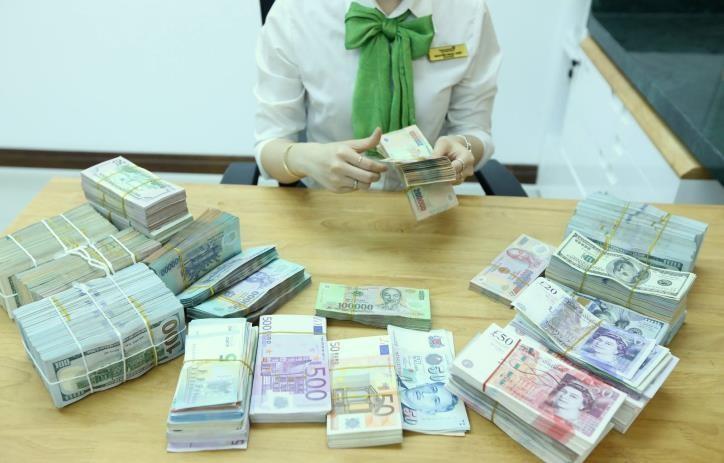 Giá đồng USD sáng 25/6 tiếp tục giảm. Ảnh minh họa: BNEWS/TTXVN
