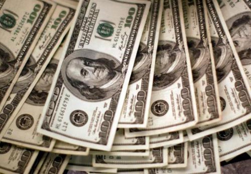 Giá USD tại Vietcombank hôm nay 20/7 tăng 10 đồng ở cả chiều mua vào và bán ra. Ảnh minh họa: TTXVN