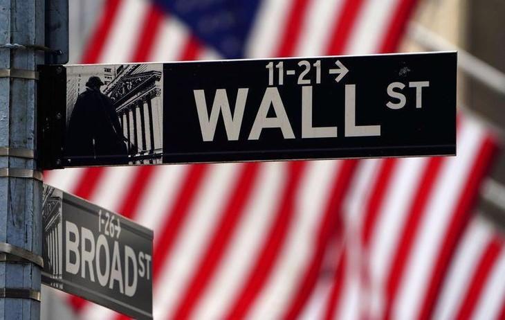 Dòng tiền dồi dào giúp chứng khoán Mỹ liên tiếp lập kỷ lục thời gian qua - Ảnh: AFP