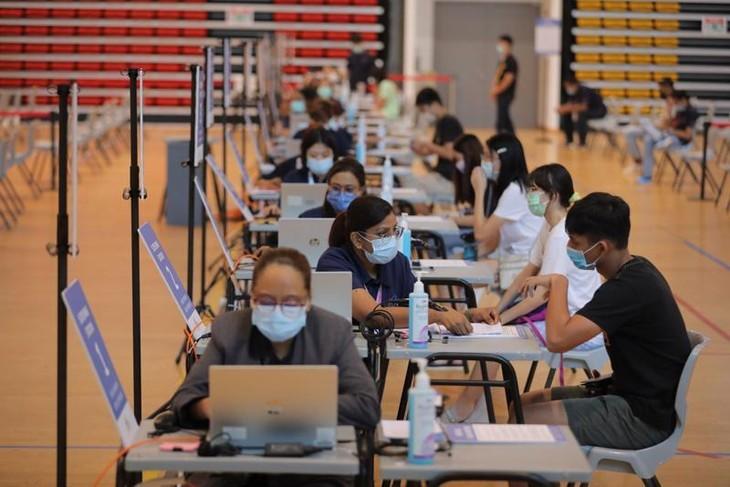 Singapore: Người chưa tiêm vaccine phải xét nghiệm 2 lần mỗi tuần