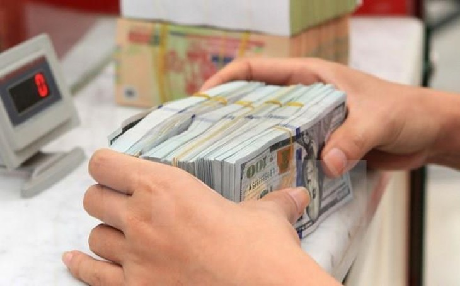 Giá USD tại Vietcombank sáng 9/9 tăng 10 đồng. Ảnh minh họa: TTXVN