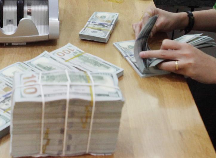 Giá USD tại Vietcombank sáng 24/9 không đổi. Ảnh: Trần Việt/TTXVN.
