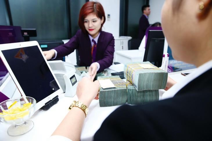 Việc giải ngân vốn sẽ được các tổ chức tín dụng hết sức cân nhắc vì nợ xấu của ngành ngân hàng dự kiến tăng trong thời gian tới. Ảnh: Nhã Chi