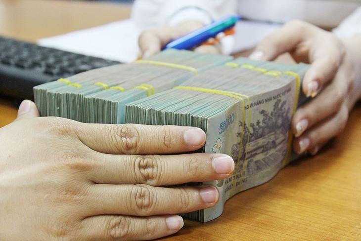 NHNN cho biết đã điều hành lãi suất phù hợp với diễn biến kinh tế vĩ mô và thị trường tiền tệ. Ảnh: Tường Lâm