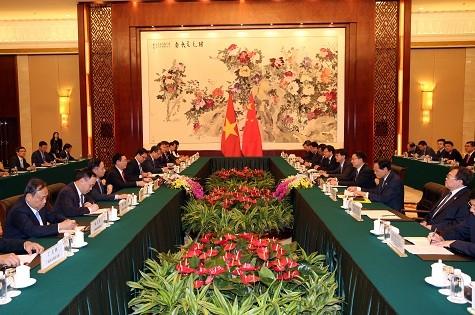 Phó Thủ tướng Vương Đình Huệ hội đàm với Phó Thủ tướng Trung Quốc ảnh 1