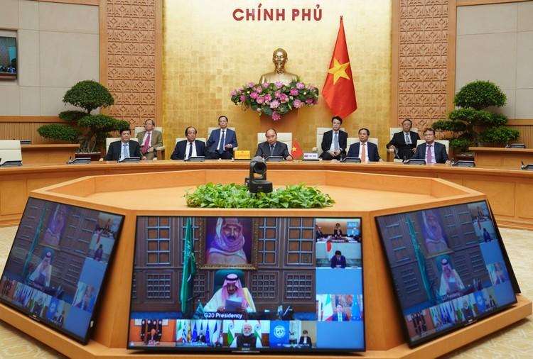 Thủ tướng dự họp thượng đỉnh trực tuyến G20 ứng phó COVID-19 ảnh 1