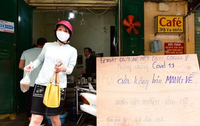 Hà Nội vắng sau lệnh đóng cửa hàng dịch vụ ảnh 7