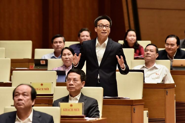 Phó Thủ tướng và các Bộ trưởng trả lời chất vấn ảnh 1
