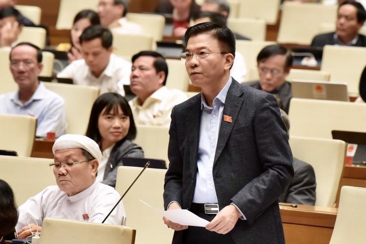 Phó Thủ tướng và các Bộ trưởng trả lời chất vấn ảnh 3