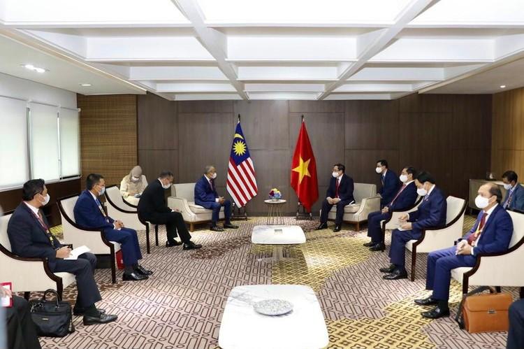 Thủ tướng Chính phủ Phạm Minh Chính gặp gỡ song phương Thủ tướng Campuchia, Singapore, Malaysia ảnh 5
